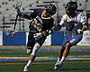 Jason Seiter #23 of Bethpage, left, reacts to a hit to the wrist by Joe Moritz #7 of Wantagh during the Nassau County varsity boys lacrosse Class C semifinals at Shuart Stadium, located on the campus Hofstra University in Hempstead, on Friday, May 25, 2018.
