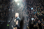 © Joel Goodman - 07973 332324 . 28/10/2017 . Manchester , UK . The audience watch James Hetfield in the foreground. Metallica perform at the Manchester Arena . Photo credit : Joel Goodman