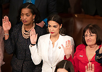 United States Representative Jahana Hayes (Democrat of Connecticut), left, US Representative Alexandria Ocasio-Cortez (Democrat of New York), center, and US Representative Annie Kuster (Democrat of New Hampshire) are sworn-in as the 116th Congress convenes for its opening session in the US House Chamber of the US Capitol in Washington, DC on Thursday, January 3, 2019. Photo Credit: Ron Sachs/CNP/AdMedia
