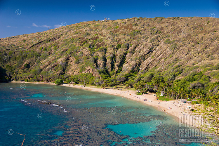 The coral reef and white sand beach at Hanauma Bay Nature Preserve, O'ahu