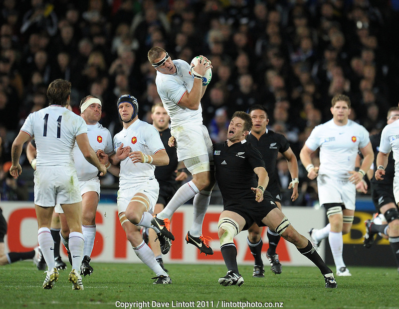 France's Imanol Harinordoquy takes a high kick under pressure from Richie McCaw during the All Blacks v France IRB Rugby World Cup 2011 final  at Eden Park, Auckland, New Zealand on Sunday, 23 October 2011. Photo: Dave Lintott / lintottphoto.co.nz