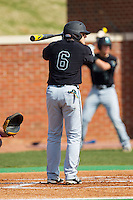 Connor Owings (6) of the Coastal Carolina Chanticleers at bat against the High Point Panthers at Willard Stadium on March 15, 2014 in High Point, North Carolina.  The Chanticleers defeated the Panthers 1-0 in the first game of a double-header.  (Brian Westerholt/Four Seam Images)