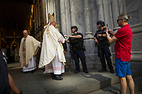 NEW YORK, NY - APRIL 16: Cardinal Timothy Dolan shakes hands with NYPD officers as he arrives to St. Patrick's Cathedral for mass while people take part in the Annual Easter parade on April 16, 2017 in New York City.  The Easter Parade and Easter Bonnet Festival is characterized by revelers dressed in their holiday finery, which typically includes handmade hats, while they gather around St. Patrick's Cathedral to show their creations. Photo by VIEWpress/Eduardo MunozAlvarez