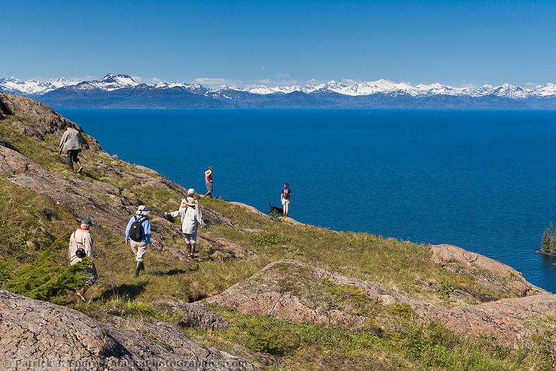 Tourists enjoy shoreside hikes in Prince William Sound, Alaska