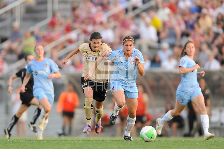 Christine Sinclair (12)  of FC Gold Pride and Brittany Taylor (14) of Sky Blue FC race for a ball. FC Gold Pride defeated Sky Blue FC 1-0 during a Women's Professional Soccer (WPS) match at Yurcak Field in Piscataway, NJ, on May 1, 2010.