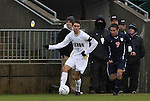 13 December 2009: Akron's Blair Gavin (left) is followed by Virginia's Neil Barlow (right). The University of Virginia Cavaliers defeated the University of Akron Zips 3-2 on penalty kicks after playing to a 0-0 overtime tie at WakeMed Soccer Stadium in Cary, North Carolina in the NCAA Division I Men's College Cup Championship game.