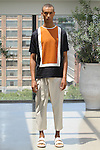 Model Drayton poses in an outfit from the Deveaux Spring Summer 2017 collection on July 13 2016, during New York Fashion Week Men's Spring Summer 2017.