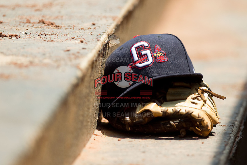 A Gwinnett Braves cap sits on top of a glove in the visitors dugout during the International League game against the Charlotte Knights at Knights Stadium on July 28, 2013 in Fort Mill, South Carolina.  The Knights defeated the Braves 6-1.  (Brian Westerholt/Four Seam Images)