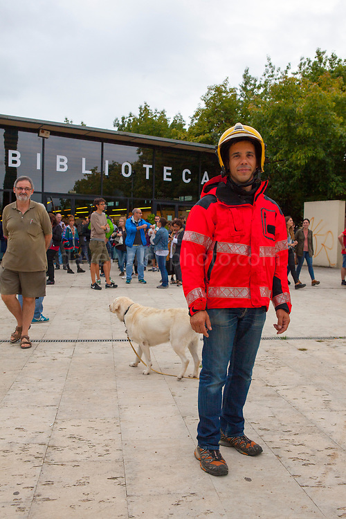 Firemen at the Biblioteca Central Gabriel Ferrater, Sant Cugat del Valles, just outside Barcelona. Catalonia&rsquo;s firemen were joined by Basque firemen in a pledge to protect voters during the October 1st referendum on independence. Elsewhere in Catalonia, they were attacked by Spanish Guardian Civil and Policia Nacional. One of the firemen, Oriol said &ldquo;we just want to protect people&rdquo;.<br /> <br /> On October 1st 2017, Catalans voted in a binding referendum to decide whether the region should stay in Spain, or leave and become an independent Republic. The Madrid government of Mariano Rajoy sent thousands of extra police into Catalonia, brutally attacking around 10% of  voting centres and seizing ballot boxes, injuring nearly 1000 people in an effort to stop the vote. Despite the violence, there was turn turnout of well more than 42% with around 90% in favour of independence. Some 770,000 votes from an electorate of 5.5 million were stolen by police forces or unable to be cast  because of raids.