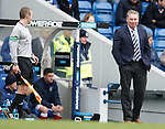 Ally McCoist chatting and winking to linesman Stuart MacMillan
