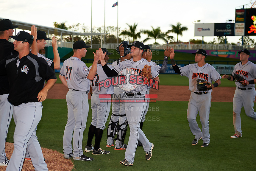 Jupiter Hammerheads second baseman Justin Bohn (3) high fives with his teammates after a game against the Fort Myers Miracle on April 9, 2017 at CenturyLink Sports Complex in Fort Myers, Florida.  Jupiter defeated Fort Myers 3-2.  (Mike Janes/Four Seam Images)