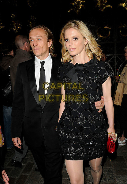 JEREMY GILLEY & EMILIA FOX.The Royal Academy Summer Exhibition 2009, Royal Academy of Arts, Piccadilly, London, England..June 3rd, 2009.full length black suit dress bow ribbon 3/4 .CAP/CAN.©Can Nguyen/Capital Pictures.