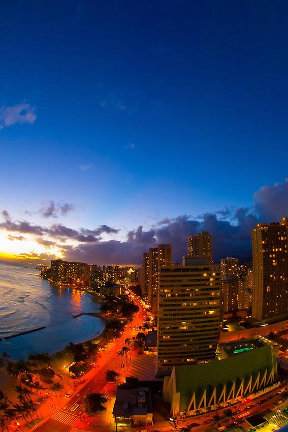 Twilight overview of the highrises of Waikiki from the Waikiki Beach Marriott Resort, Honolulu, Oahu, Hawaii, USA