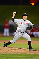 Wisconsin Timber Rattlers pitcher Rodolfo Fernandez #39 delivers a pitch during a game against the Peoria Chiefs on May 25, 2013 at Dozer Park in Peoria, Illinois.  Peoria defeated Wisconsin 6-0.  (Mike Janes/Four Seam Images)