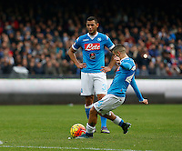 Napoli's Lorenzo Insigne kicks the ball and scores  during the  italian serie a soccer match,between SSC Napoli and Empoli      at  the San  Paolo   stadium in Naples  Italy , January 31, 2016