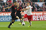 30.11.2019, RheinEnergieStadion, Koeln, GER, 1. FBL, 1.FC Koeln vs. FC Augsburg,<br />  <br /> DFL regulations prohibit any use of photographs as image sequences and/or quasi-video<br /> <br /> im Bild / picture shows: <br /> Rani Khedira (FC Augsburg #8),  im Zweikampf gegen  Simon Terodde (FC Koeln #9), <br /> <br /> Foto © nordphoto / Meuter