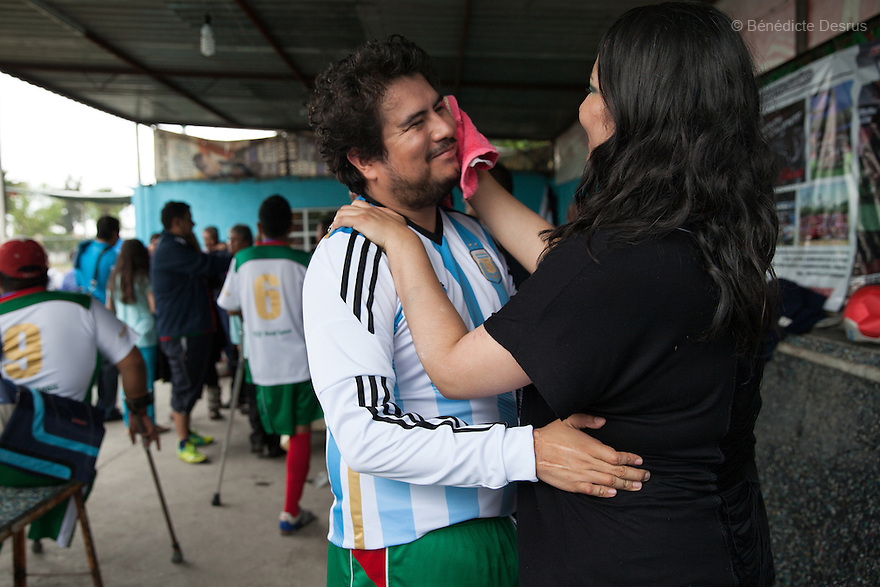 "Osman Cristobal González Ruiz (L), a player from Guerreros Aztecas with his girlfriend (R) after a match in Mexico City, Mexico on July 5, 2014. Osman, 31, lost his left leg in an electrical accident at work when he was 23. Guerreros Aztecas (""Aztec Warriors"") is Mexico City's first amputee football team. Founded in July 2013 by five volunteers, they now have 23 players, seven of them have made the national team's shortlist to represent Mexico at this year's Amputee Soccer World Cup in Sinaloa this December. The team trains twice a week for weekend games with other teams. No prostheses are used, so field players missing a lower extremity can only play using crutches. Those missing an upper extremity play as goalkeepers. The teams play six per side with unlimited substitutions. Each half lasts 25 minutes. The causes of the amputations range from accidents to medical interventions – none of which have stopped the Guerreros Aztecas from continuing to play. The players' age, backgrounds and professions cover the full sweep of Mexican society, and they are united by the will to keep their heads held high in a country where discrimination against the disabled remains widespread. (Photo by Bénédicte Desrus)"