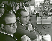 Aboard USS Hornet - (FILE) -- United States President Richard M. Nixon and Dr. Thomas O. Paine, NASA Administrator, watch Apollo 11 astronauts Neil A. Armstrong, Michael Collins and Buzz Aldrin Jr., walk from the recovery helicopter to the Mobile Quarantine Facility aboard the U.S.S. Hornet on July 24, 1969. The President later congratulated the astronauts by microphone, speaking through a window of the quarantine trailer. During the eight-day space mission, Armstrong and Aldrin explored the Moon's surface and brought back rock samples for scientists to study. Collins piloted the command module in the lunar orbit during their 22-hour stay on the moon. The extravehicular activity lasted more than two hours..Credit: NASA via CNP