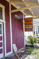 """Old """"Gold Bond Stamps"""" sign hanging in front of old store in Honomu, Big Island, Hawaii"""