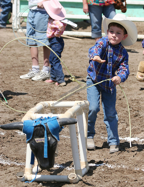 Brayden Worthington competes in the Pee-Wee Dummy Roping event at the Fallon Junior Rodeo.  Photo by Tom Smedes.