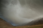Storm clouds over mountain valley, Sarychat-Ertash Strict Nature Reserve, Tien Shan Mountains, eastern Kyrgyzstan