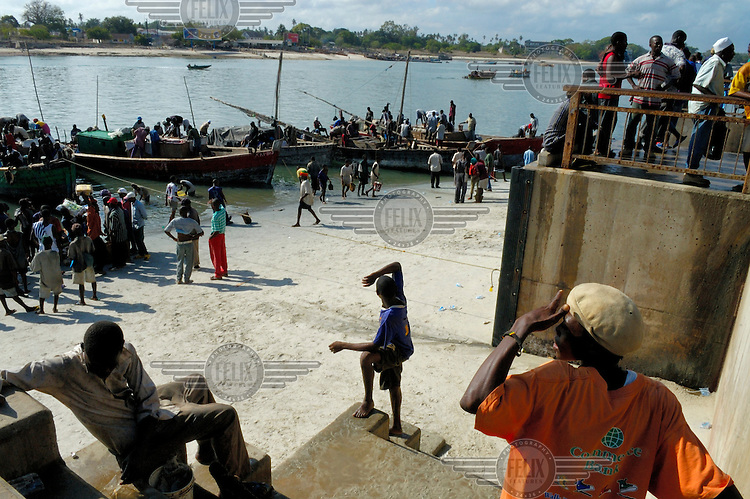 Looking for fishing boats to arrive at Magogoni fish market.