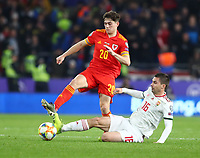 19th November 2019; Cardiff City Stadium, Cardiff, Glamorgan, Wales; European Championships 2020 Qualifiers, Wales versus Hungary; Mate Patkai of Hungary slides in to win the ball from Daniel James of Wales - Editorial Use