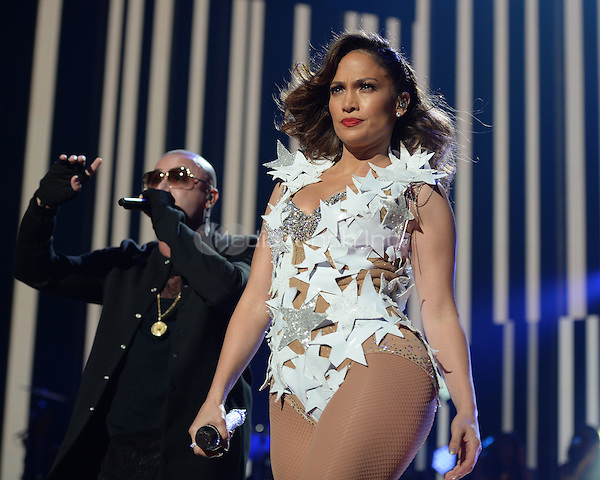 MIAMI, FL - NOVEMBER 07: Jennifer Lopez and Wisin perform during the iHeartRadio Fiesta Latina concert at American Airlines Arena on November 7, 2015 in Miami, Florida. Credit: mpi04/MediaPunch
