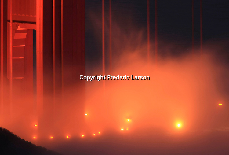 The evening fog danced through the lights off the deck of the Golden Gate Bridge in California.