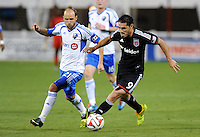 Washington D.C. - May 17, 2014: Fabian Espindola (9) of D.C. United goes against Justin Mapp (21) of Montreal Impact.  D.C. United tied the Montreal Impact 1-1 during a Major League Soccer match for the 2014 season at RFK Stadium.