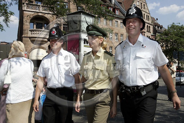 NÜRNBERG - GERMANY -- 14  JUNE 2006 -- FIFA Worldcup 2006. -- English Bobbies (police) patrolling with a German female police officer in  the center of Nuremberg. -- PHOTO:  JUHA ROININEN / EUP-IMAGES