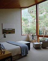 The windows of the neutrally decorated and serene rear bedroom look out onto the desert landscape