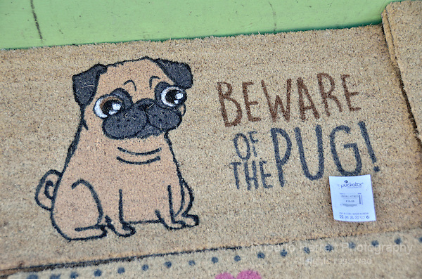 Beware of the Pug sign on a doormat