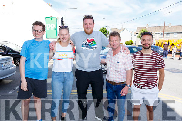 Eoin O'Sullivan, Aisling O'Mahoney, John Murphy, Noel Conway and Matt O'Dowd enjoying the carnival atmosphere on Rock Street as they await the Race of Champions annual race on Monday.