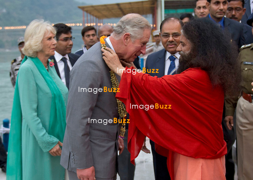 PRINCE CHARLES AND CAMILLA IN INDIA.<br /> observe the Sunset &quot;Aarti&quot; Ceremony by the Ganges in the holy Hindhu city of Rishikesh, Uttrakhand_06/11/2013