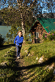 USA, Alaska, Redoubt Bay, Big River Lake, a young girl playing on the grounds at Redoubt Bay Lodge