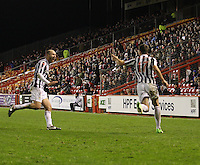 Sam Parkin runs to congratulate Kenny McLean in the Aberdeen v St Mirren Scottish Communities League Cup match played at Pittodrie Stadium, Aberdeen on 30.10.12.