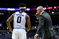 Washington, DC - MAR 10, 2018: Rhode Island Rams head coach Dan Hurley talks with Rhode Island Rams guard E.C. Matthews (0) during a free throw attempt of the semi final match up of the Atlantic 10 men's basketball championship between Saint Joseph's and Rhode Island at the Capital One Arena in Washington, DC. (Photo by Phil Peters/Media Images International)