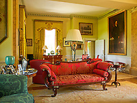 An Empire-style sofa occupies centre stage in this formal drawing room