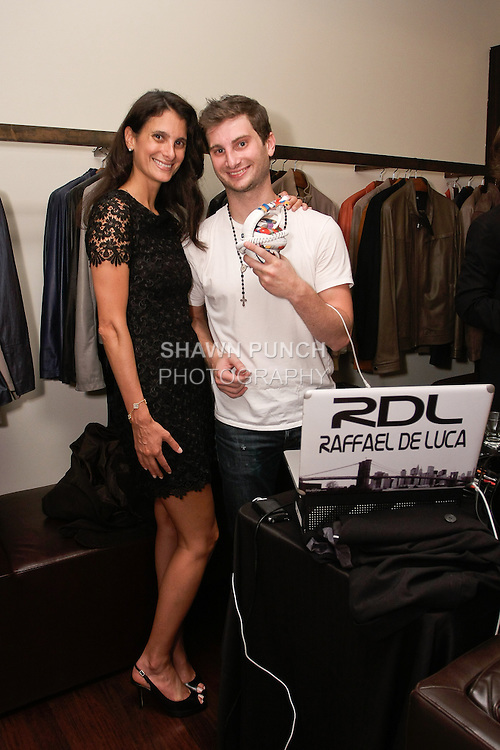 DJ Raffael De Luca poses with woman at the Fratelli Rossetti Fashion Night Out event on 625 Madison Avenue, during New York Fashion Week, September 8, 2011.