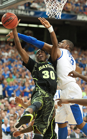 UK forward Terrence Jones defends a shot by Baylor Bears forward Quincy Miller. Kentucky faced Baylor during the 2012 NCAA Tournament Regional Finals at the Georgia Dome in Atlanta, March 25, 2012. Photo by Derek Poore