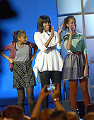 """First lady Michelle Obama, center, Sasha Obama, left, and Malia Obama, right, arrive at the """"Kids' Inaugural: Our Children. Our Future at the Washington Convention Center in Washington, D.C. on Saturday, January 19, 2013.  .Credit: Ron Sachs / CNP.(RESTRICTION: NO New York or New Jersey Newspapers or newspapers within a 75 mile radius of New York City)"""