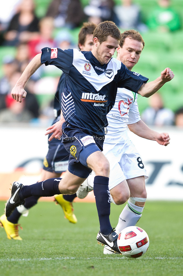 MELBOURNE, AUSTRALIA - AUGUST 22, 2010: Mate Dugandzic from the Victory controls the ball in Round 3 of the 2010 A-League between the Melbourne Victory and North Queensland Fury at AAMI Park on August 22, 2010 in Melbourne, Australia. (Photo by Sydney Low / Asterisk Images)