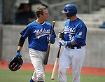 Western Nevada College Wildcats' Sam Hall, right, greets Joey Krunkilton at the plate after he hit a home run in a college baseball game against Colorado Northwestern at John L. Harvey Field in Carson City, Nev., on Friday, April 11, 2014. <br /> Photo by Cathleen Allison/Nevada Photo Source