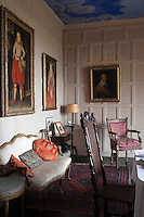 The dining room has 17th century panelling and portraits and stands on the site of the medieval chapel