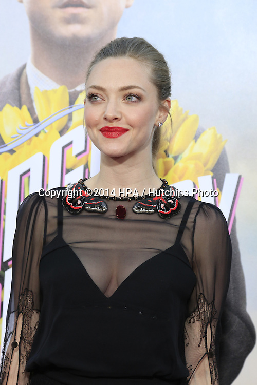 "LOS ANGELES - MAY 15:  Amanda Seyfried at the ""A Million Ways To Die In The West"" World Premiere at Village Theater on May 15, 2014 in Westwood, CA"