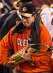 Clemson head coach Dabo Swinney cradles the Championship trophy as he celebrates defeating Alabama to win the 2017 College Football Playoff National Championship in Tampa, Florida on January 9, 2017.  Clemson defeated Alabama 35-31. Photo by Mark Wallheiser/UPI