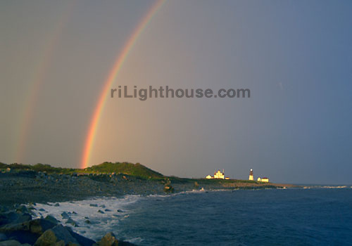 A double rainbow extends over Point Judith Lighthouse