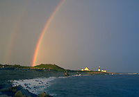 A double rainbow extends over Point Judith Lighthouse