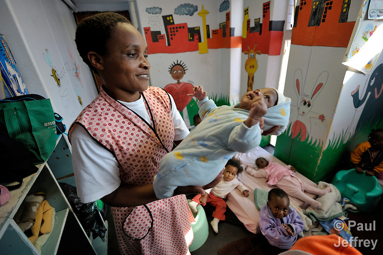 Cecilia Nyamugafata cares for refugee children from Zimbabwe and other African countries in a day care center at the Central Methodist Church in Johannesburg, South Africa. The church is home to more than 3,000 refugees suffering from economic desperation and sporadic xenophobic attacks.
